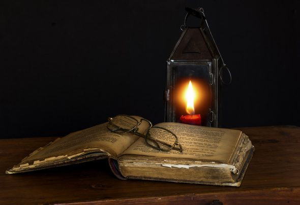 Old book and lamp